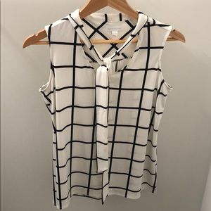 Brand new sleeveless blouse. White windowpane